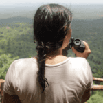 Com. Livelihoods Cambodianwomanlookingatfroestlandscape 150x150