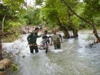 wildlife alliance rangers fighting loggers in cambodia Wildlife Alliance Rangers fighting loggers in Cambodia Rangers crossing the river on motorbyke 200x150