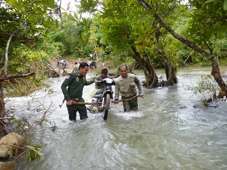 wildlife alliance rangers fighting loggers in cambodia Wildlife Alliance Rangers fighting loggers in Cambodia Rangers crossing the river on motorbyke