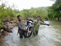 Wildlife Alliance Rangers fighting loggers in Cambodia Rangers motorbyke river 200x150