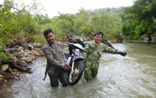 Wildlife Alliance Rangers fighting loggers in Cambodia Rangers motorbyke river 320x202  Newsletter Rangers motorbyke river 320x202