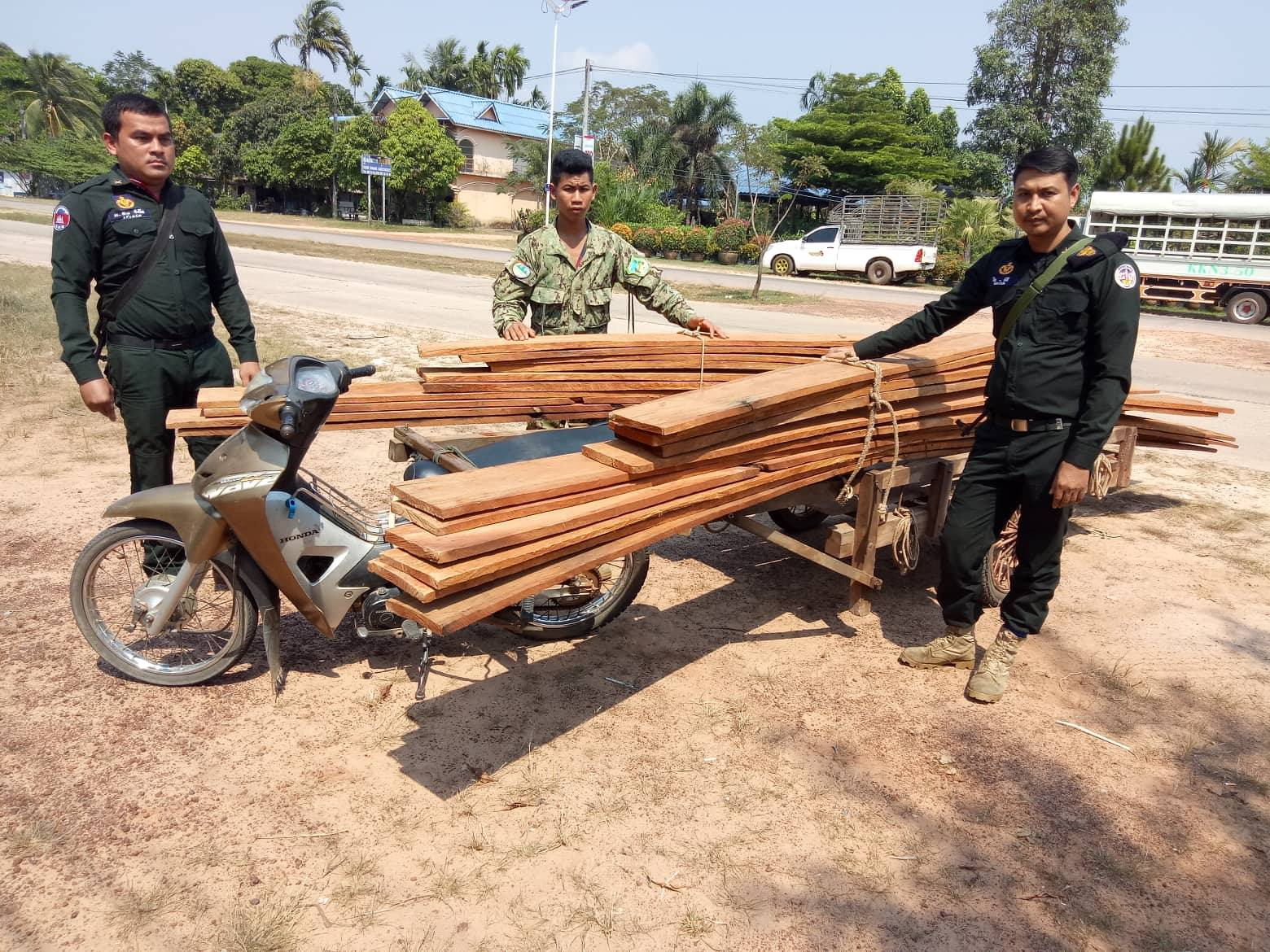 construction timber The rangers stopped one motorbike transporting construction timber Illegal timber Cambodia